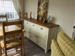 Customer photo 2 - Country Cottage 140cm Cream Painted Large Oak Sideboard in a dining room.