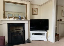 Toulouse White Painted Corner TV Unit with Drawer customer photo in a Victorian house