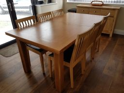 Customer photo 1 - Country oak 280cm large double extending dining table in a customers dining room next to a sideboard.