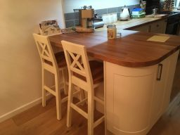 Customer photo 1 - Billy Cross Back Cream Painted Bar Stool - Oak Seat against a solid oak and cream painted kitchen island.