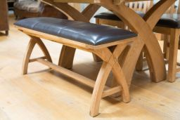 Wooden dining bench made of solid oak with brown leather seat pad 1.6m long