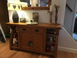 Customer photo 1 - Country Oak 150cm Cross Leg Oak Sideboard at the base of the customers stairs near the hallway making it the focal point of the dining room.