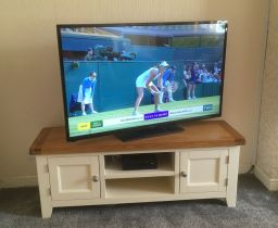 Customer photo 1 - Country Cottage Cream Painted Large Double Door Oak TV Unit in a customer living room with a large wide screen TV.