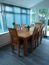 Customer photo 1 - Westfield Solid Oak Chair Brown Leather with a matching oak extending table in a conservatory.