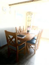 Customer photo 2 - Grasmere oak carver dining chair next to a country Oak cross leg dining table.