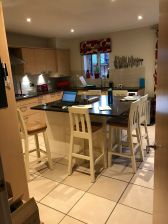 Customer photo 2- Billy Cream Painted Kitchen Stool - Oak Seat around a stunning kitchen island.