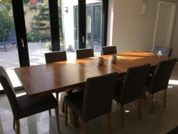 Customer photo 1 - Country Oak 280cm cross leg extending oak dining table with fabric dining chairs in a customers dining room.